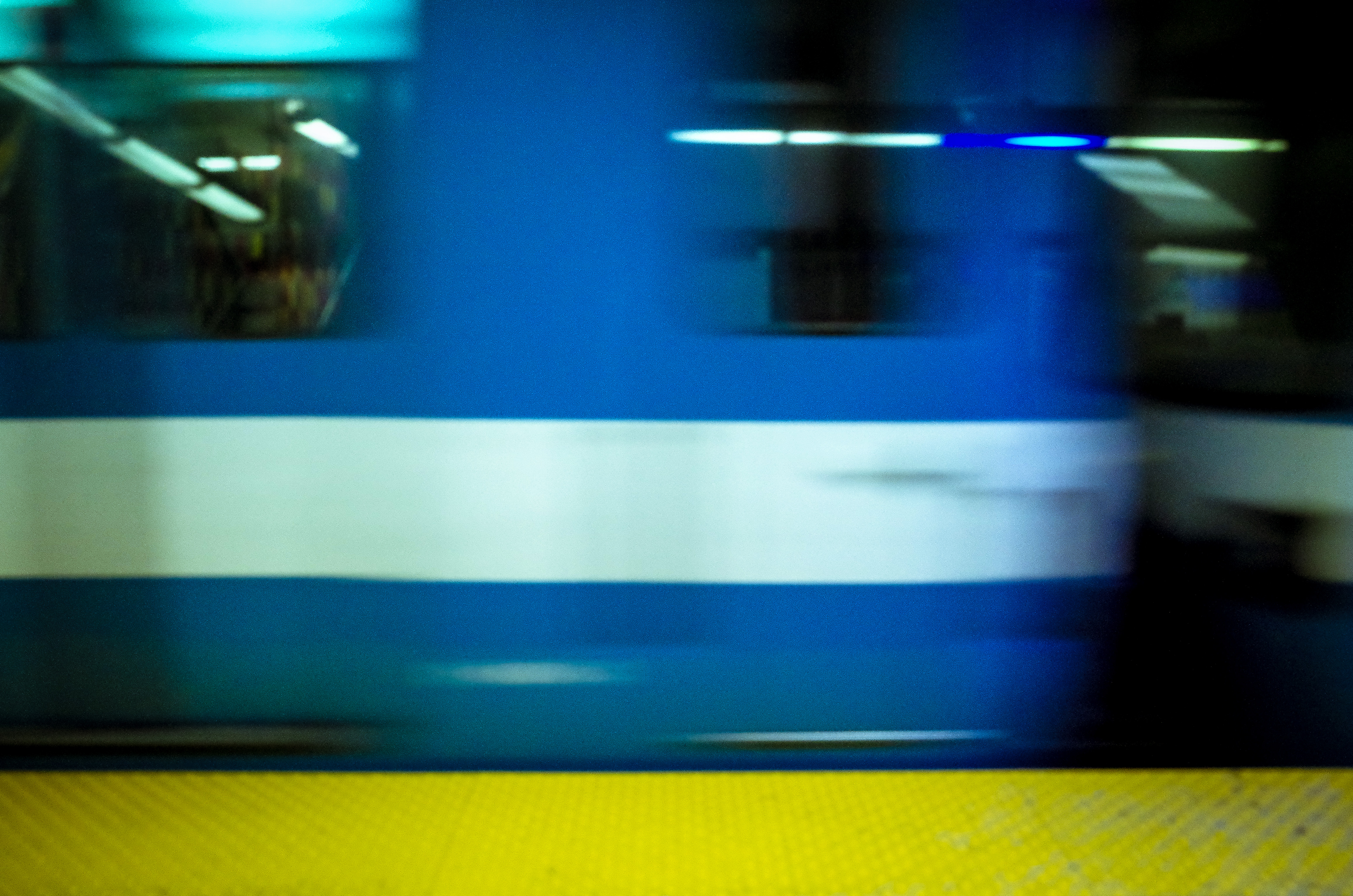 moving blue metro and yellow sign