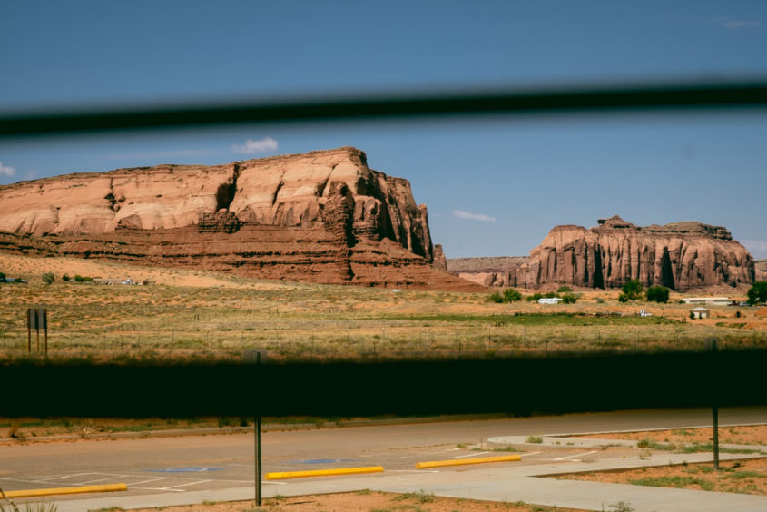 window blinds open with view of monument valley