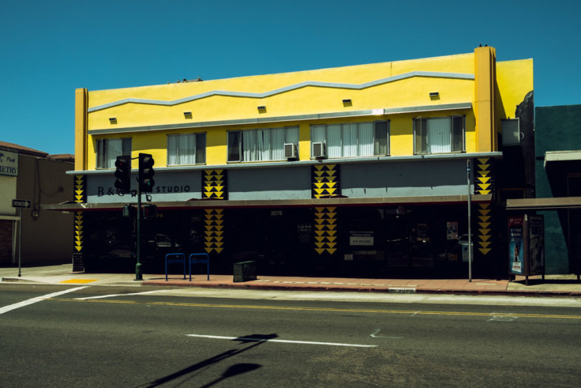 yellow building on empty street